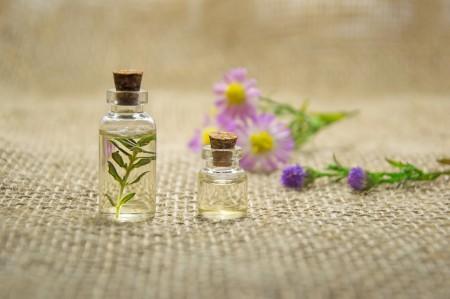 massage oil, flowers, bottles